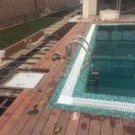 Отделка термодеревом площадки вокруг бассейна